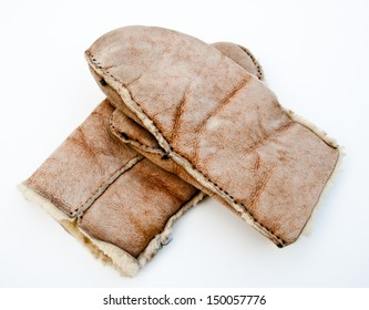 These heavy handmade sheepskin mittens have seen years of use in keeping hands warm.