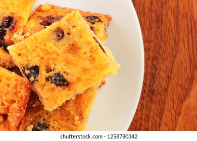 These homemade melt in your mouth shortbread squares are easy to bake with dried cranberries and can be served for appreciative guests during the holiday as well as packed in your children's lunch box
