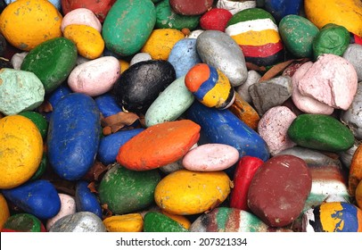 These large round pebbles painted in bright colors make for a nice cheery background