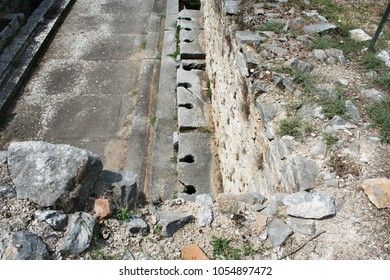 These are the public toilets at the ruins from Ancient Philippi. These toilets date to the 3rd century AD. Philippi was the home of Lydia the merchant who befriended the Apostle Paul in Acts 16.