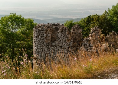 These are the ruins of the castle, which is marked by battle. - Shutterstock ID 1476179618