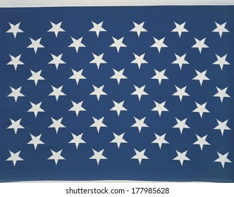 These are the stars of the American flag. They lay flat against their blue background.