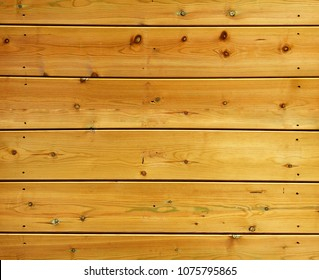 These varnished wooden slats can be seamlessly repeated on a vertical axis (but not horizontally)
