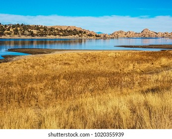 These are the wetlands of Watson Lake in the Granite Dells of Prescott, Arizona, where many serious bird watchers congregate.