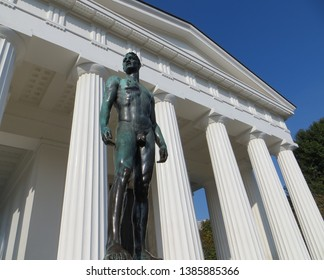 The Theseus Temple in Vienna's Volksgarten is a Grecian-style temple built in 1819-1923. The art nouveau statue of handsome necked aryan man, Vienna, Austria.