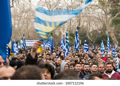 Thessaloniki / Greece - 01/21/2018 : a Crowd of  unknown Greek People celebrate at the Greek Rally for the Name Macedonia holdings signs and waving Greek Flags