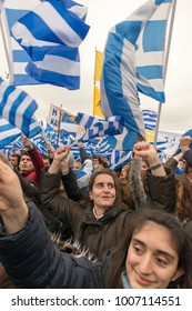 Thessaloniki / Greece - 01/21/2018 : unknown Greek People of all ages celebrate at the Greek Rally for the Name Macedonia holdings signs and Greek Flags