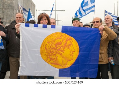 Thessaloniki / Greece - 01/21/2018 : unknown Greek People of all ages celebrate at the Greek Rally for the Name Macedonia holding signs and Greek Flags