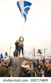 Thessaloniki / Greece - 01/21/2018 : Unknown Greek man is waving a Huge Greek Flag at the Rally for the Name Macedonia in Thessaloniki Greece .