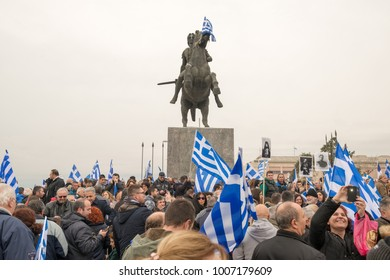 Thessaloniki / Greece - 01/21/2018 : unknown Greek people are waving their Greek Flags next to the statue of Alexander the Great at the rally for the name Macedonia in Thessaloniki Greece