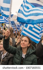 Thessaloniki / Greece - 01/21/2018 : Unknown Greek woman is waving her Greek flag at the rally for the name Macedonia in Thessaloniki Greece