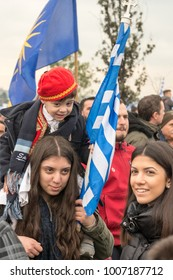Thessaloniki / Greece - 01/21/2018 :Unknown greek family holding a little boy waving their Greek Flag at the rally for the name Macedonia in Thessaloniki Greece