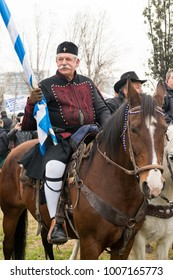 Thessaloniki / Greece - 01/21/2018 : unknown old Greek man is Holding a Greek Flag celebrating at the Rally for the name Macedonia in Thessaloniki Greece