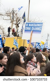 Thessaloniki / Greece - 01/21/2018 : unknown People celebrate at the Greek Rally in Thessaloniki Greece for the Name Macedonia while Holding signs