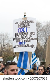 Thessaloniki / Greece - 01/21/2018 : unknown People celebrate at the Greek Rally for the Name Macedonia while Holding a sign saying Macedonia is Greek not Skopje