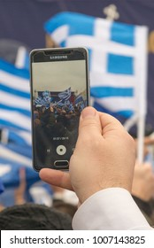 Thessaloniki / Greece - 01/21/2018 : Unknown person is holding a cellphone recording the Rally for the name Macedonia in Thessaloniki Greece
