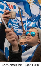 Thessaloniki / Greece - 01/21/2018 : a young man is taking a video of the rally for the name of Macedonia in Thessaloniki Greece