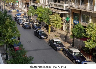Thessaloniki, Greece - 24 October 2016: Taxis at a taxi stand at the city center. Blue and white parked taxis at Agias Sofias and Mitropoleos street by Metropolitan church of Saint Gregory Palamas.