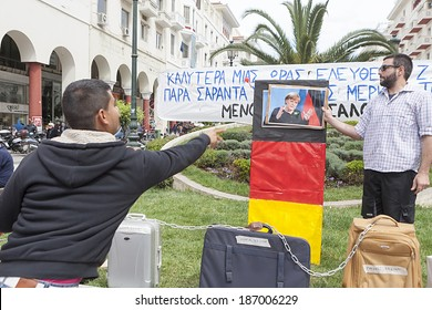 THESSALONIKI, GREECE - APRIL 11, 2014 : Symbolic representation of protest against the visit of the German Chancellor, Angela Merkel in Athens, did new initiative in Aristotle Square in Thessaloniki