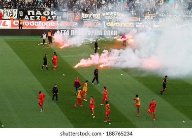 THESSALONIKI, GREECE APRIL 16, 2014 : Flares in the field during the training before the Greek Cup Semi Final match PAOK vs Olympiacos