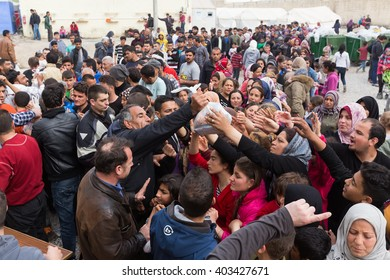 Thessaloniki, Greece - April 2, 2016: Refugees living in tents at the relocation center Diavata waiting in line to get food