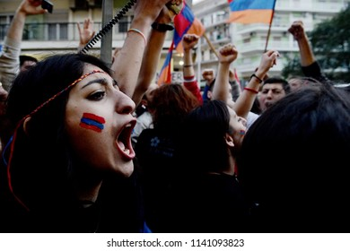 Thessaloniki, Greece - April 24, 2015. Armenian people chant slogans as they march during a protest to commemorate the Armenian Genocide by the Ottoman Empire.