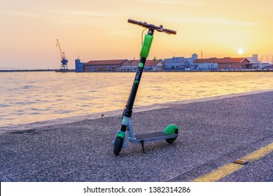 Thessaloniki, Greece - April 26 2019: A parked Lime electric Scooter rental without passenger. A green and black ride sharing Lime-S electric scooter by the street, ready to be used by the next rider.