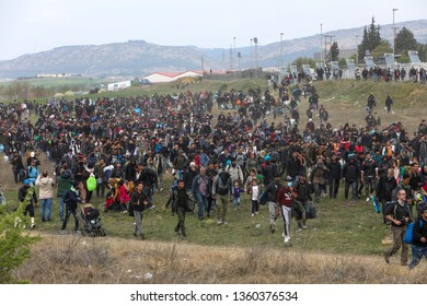 Thessaloniki, Greece - April 5, 2019: Hundreds of migrants and refugees gathered outside of a refugee camp in Diavata to walk until the Northern borders of Greece to pass to Europe.