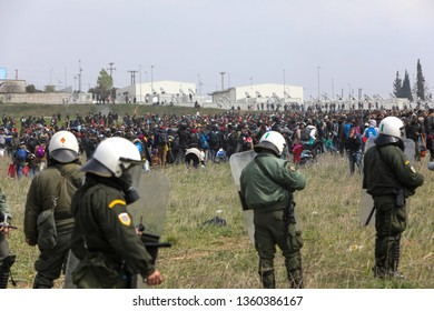 Thessaloniki, Greece - April 5, 2019: Migrants clashes with Greek riot police outside of a refugee camp in Diavata. Migrants and refugees gathered to walk to the border of Greece to pass to Europe