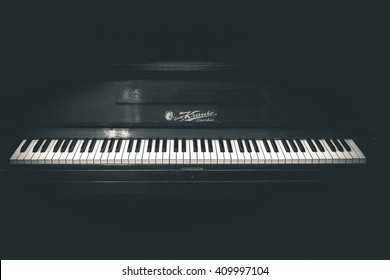 Thessaloniki, Greece - April 6, 2016: Close up shot of an old beautiful piano in black and white photo showing how much it been used in the past in Thessaloniki Greece