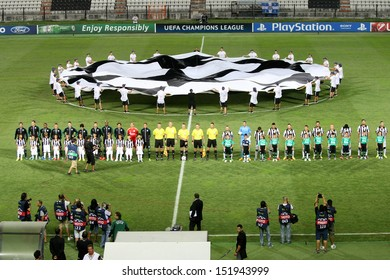 THESSALONIKI, GREECE - AUG 27 : Front view of the teams during the Champions League Anthem before the Champions League play-off match PAOK vs Schalke on Aug 27, 2013 in Thessaloniki, Greece.