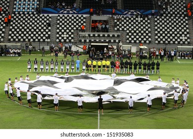 THESSALONIKI, GREECE - AUG 27 : Rear view of the teams during the Champions League Anthem before the Champions League play-off match PAOK vs Schalke on Aug 27, 2013 in Thessaloniki, Greece.