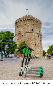 Thessaloniki, Greece - August 15 2019: Parked Lime electric Scooter rentals without passenger. Green & black ride sharing Lime-S electric scooters before White Tower landmark ready for the next rider.