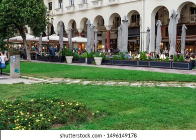 Thessaloniki, Greece - August 15 2019: People enjoying coffee at city center cafe bars. Crowd drinking frape or other beverage at outdoors seating bars in the pedestrian area of Aristotelous square.