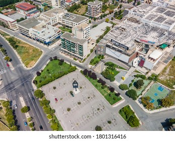 Thessaloniki, Greece - August 16 2020: Aerial drone landscape view of One Salonica Outlet Mall. Day top panorama of discount shops area with sign & parking, located at western part of city entrance.