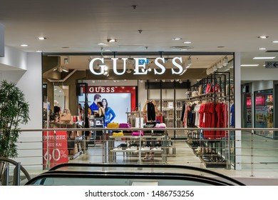 Thessaloniki, Greece - August 24 2019: Guess outlet retailer store interior. Clothing brand store with discount prices at MEGA Outlet shopping center mall in Northern Greece at Pylaia area.