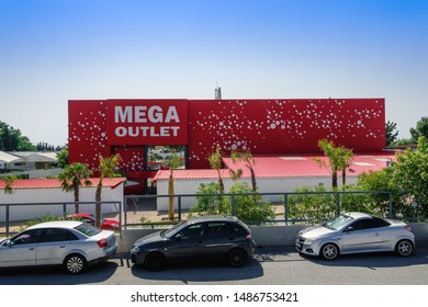 Thessaloniki, Greece - August 24 2019: MEGA Outlet shopping mall facade. Day view of discount shopping center entrance in Northern Greece, at Pylaia area, with red & white logo art.