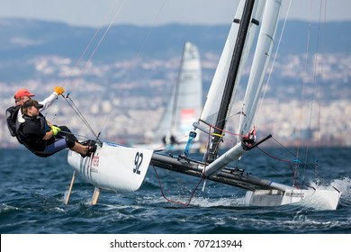 """Thessaloniki, Greece - August 30, 2017: Athletes yachts in action during """"2017 Tornado Open World, Global Mixed and Youth championships"""""""