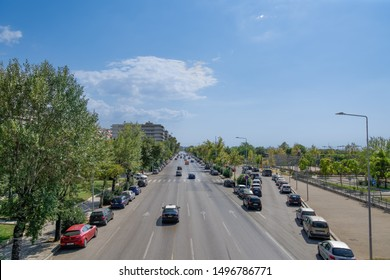 Thessaloniki, Greece - August 31 2019: city road traffic on a multi lanes avenue. Elevated day sunny view of Leoforos Megalou Alexandrou with passing cars.
