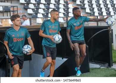 Thessaloniki, Greece - August 6, 2019: Players of Ajax Player of Ajax Kik Pierie(L), Ziyech(C) and Quincy Promes (R) during a training session before a Champions League match with PAOK FC at Toumba s