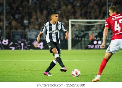 Thessaloniki, Greece - August 8, 2018. PAOK FC defender Leo Matos (Left) in action during a soccer match between PAOK FC and Spartak Moscow for the Champions League third qualifying round.