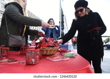 """Thessaloniki, Greece - December 1, 2018. Members of the Greek Control and Prevention of Diseases Center, distribute condoms and informative material, during the events for the """"World AIDS Day""""."""