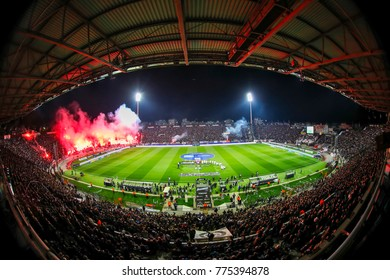 Thessaloniki, Greece - December 10, 2017 : Interior view of the full at Toumba Stadium full of fans and supporters of PAOK who light flares  during the Greek Superleague match PAOK vs Panathinaikos