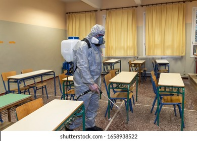 Thessaloniki, Greece - Feb 28, 2020: Workers sprays disinfectant as part of preventive measures against the spread of the COVID-19, the novel coronavirus, in a school