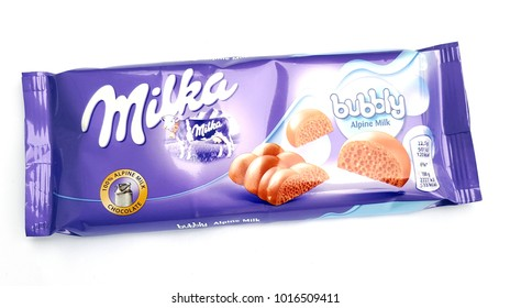 THESSALONIKI, GREECE -  FEBRUARY 02, 2018 : Bar of Milka chocolate on white background. Milka is a brand of chocolate confection which originated in Switzerland in 1901.