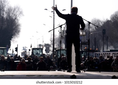 Thessaloniki, Greece - February 1, 2018. The silhouette of a farmer is seen, as he holds a speech during a farmers protest against their income cuts.