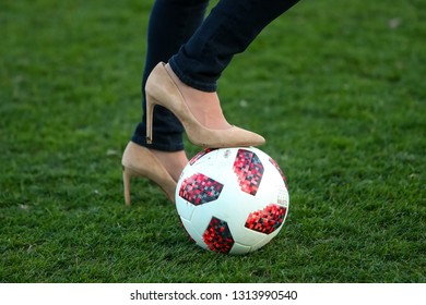 Thessaloniki, Greece - February 10, 2019: Close up ladies legs with heels shoes over to the ball during a Greek Superleague soccer match between PAOK vs Olympiacos played at Toumba stadium