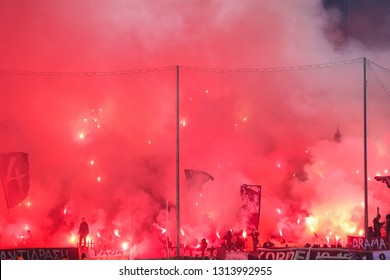 Thessaloniki, Greece - February 10, 2019: View of fans of PAOK who light flares during Greek Superleague match between PAOK and Olympiacos played at Toumba stadium