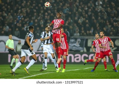 Thessaloniki, Greece - February 10, 2019: player of Olympiacos Pape Abou Cisse (C) in action during a Greek Superleague soccer match between PAOK and Olympiacos played at Toumba stadium
