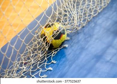 Thessaloniki, Greece - February 13, 2016: Handball ball on the goalpost net prior to the Greek Women Cup Final handball game Arta vs Nea Ionia
